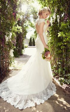 See these Tulle over Lavish Satin cap sleeve wedding dresses featuring intricate floral Lace embellishments, sparkling Diamante beading, and a keyhole back.