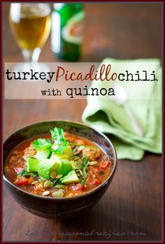 Turkey Picadillo Quinoa Chili - a hearty, warm-weather chili made healthy with quinoa and ground turkey. Perfect for game day!