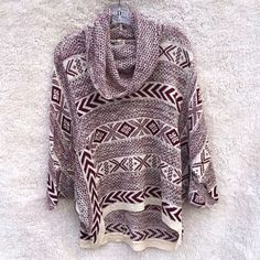 Burgundy white tribal knit poncho Super cozy poncho in a warm knit / crochet material covered in tribal Aztec Navajo patterns with geometric shapes. Brand new, never worn, no flaws. The red has sort of purple undertones. ‼️NO TRADES‼️ Sweaters Shrugs & Ponchos