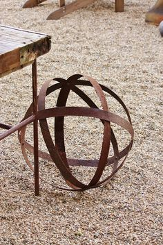 Iron orb make from old whiskey barrel rings.
