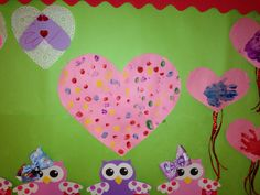 Each child used a different color to add thumbprints to a large heart as a group Valentine project. http://www.christinashomechildcare.com/#!about_us/cjg9