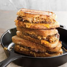 Patty Melts w/ Special Sauce -- pan-grilled ground beef patties, caramelized onion, cheddar cheese, and special sauce on toasted sourdough bread.