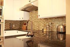 tile backsplash, kitchen countertop installation, white cabinetry, contemporary kitchen