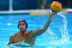 Peter Varellas throws during a match against Montenegro. (Alexander Hassenstein / Getty Images / July 29, 2012)