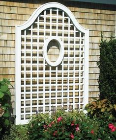 "Cameo Lattice - With it's 18"" H, 12"" W oval cut-out and distinctive, gentle arch on top, this is the epitome of grace and style. 4"" sq. H/V lattice opening. Lattice thickness is 5/8"" x 1 1/8"". 90"" H, 60"" W. Solid cellular PVC prefinished in white or green. Mounting hardware not included."