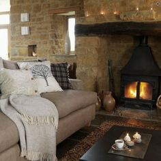 Insert a free standing wood burning fireplace/stove into a large fireplace box. Its a great idea for cutting down heat loss while keeping a fire in the fireplace.