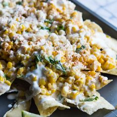 Mexican street corn nachos are fully loaded for the best appetizer ever.
