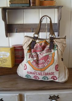 i have a teddy bear made out of this funk farms feed sack that i bought easily 24 years ago and it still sits out. Distressed Leather, Canvas Leather, Weekender Tote, Tote Bag, Feed Sack Bags, Inside Bag, How To Make Handbags, Purses And Bags, Bloomington Illinois