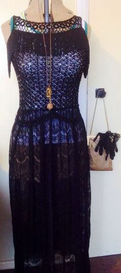 3.5 hour refashion of a moth eaten bodice into an art deco inspired black lace couture dress........ 100% hand sewn.