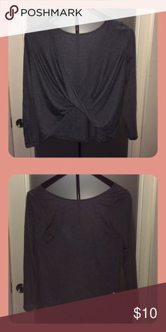 """Front Crossed Long Sleeve Grey long sleeve with crossed fabric. The fabric can be thin, because it is meant to be worn for working out. However, I always used it as a """"fancy"""" shirt. Fits pretty true to size! Tops Tees - Long Sleeve"""