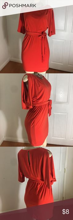 Jessica Simpson Cold Shoulder Coral Dress Dress is in good used condition. Normal wear. Cold shoulders. Lined. Very stretching and thick. Fits true to size. Brings a tie to be wrapped at waist. Peekaboo at back. Gorgeous Dress. Price is firm, thanks. No offers for this item. Jessica Simpson Dresses