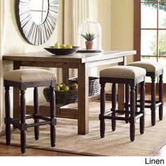 Designed with a durable wooden frame and cushioned seat, these stylish counter-height stools are finished in a rich coffee tone accentuated by linen or grey-tone upholstery. Contemporary nail head trim finishes the look of these trendy stools.