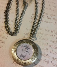 "Handmade Always in My Heart Antique Bronze Photo Locket Necklace. Locket measures 1.5"" diameter. You put any photo you like inside and can change the photo out at any time. Includes 24"" chain."