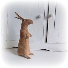 This little rabbit is made from Osnaburg. She has been dyed with strong coffee, baked in the oven, then gently sanded to give her a wonderfully vintage appearance. By Northfield Primitives Primitive Doll Patterns, Primitive Crafts, Old Bookcase, Creature Feature, Old Toys, Softies, Easter Bunny, Happy Easter, Decorative Items