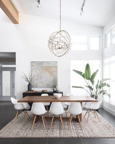Gorgeous 30 Modern Minimalist Dining Room Design Ideas for Comfortable Dinner With Your Family Dining Room Decor decorating ideas for small dining room walls Yellow Dining Room, Dining Room Walls, Dining Room Design, Dining Chairs, Dining Nook, Dining Room With Rug, Room Chairs, Dinning Room Lights, Yellow Chairs