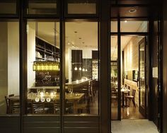 The dining room at Bar Bambino features warm, minimalist design, like a recycled wine bottle chandelier.