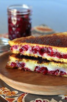 Cranberry sauce grilled cheese--with plenty of ooey gooey melted cheese, sweet-tart cranberry sauce, and two thick slices of pumpkin yeast bread, #Thanksgiving #leftovers just got awesome. | APPLE A DAY #MeatlessMonday