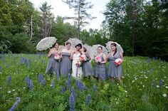 Soft grey dresses, a field of blue mountain flowers and pretty lace parasols, it's a lovely photo opportunity