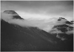"""Mountain partially covered with clouds, """"In Glacier National Park,"""" Montana. by The U.S. National Archives (Ansel Adams)"""
