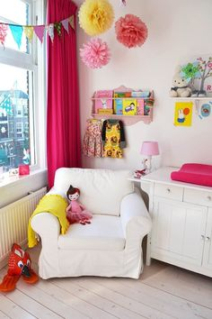 LOVING the touches of pink in this nursery in the Netherlands! What a sweet reading nook, too. /ES
