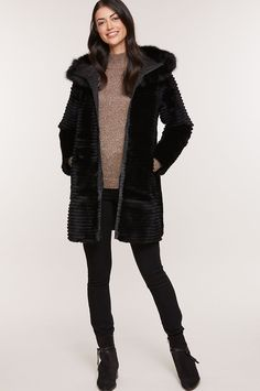 Indulge in your luxurious side one day and your sporty side the next with the Rosie ¾-length hooded jacket, reversible and ready for winter. Made from silky-soft Spanish Rex rabbit fur formed into sleek horizontal stripes, this versatile zip-front coat reverses to a sleek microfiber side, lending a more casual look and feel. Worn either way, the hood is trimmed with plush Finnish fox fur, adding an extra dash of luxe style and warmth to your day. Featuring two zip pockets on the fabric side… Sheepskin Slippers, Sheepskin Coat, Hooded Jacket, Bomber Jacket, Rabbit Fur Jacket, Rex Rabbit, Fox Fur, Fur Trim, Casual Looks