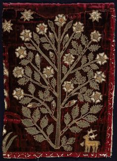 Museum of Fine Arts, Boston Fragment; Possibly English, 16th century   Small panel of red velvet with design of flowering tree with white blossoms and green leaves appliqué of green cloth of gold and white cloth of silver, outlined with couched gold cord, three eight pointed stars above, small deer below at the right, very much worn and velvet patched.