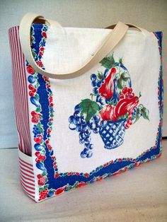 This generous sized bag would make a great market tote. Front panel is made from  a vintage tea towel featuring a fruit basket in red, blue and green