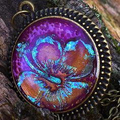 Purple Hibiscus by purplecactusstudios, via Flickr ~ Polymer clay, foils and resin . . . Beautiful