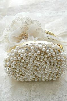 An elegant little pearl clasp bag...perfect for the wedding day essentials.