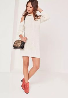 Cosy up this season with this cold shoulder knit mini dress.
