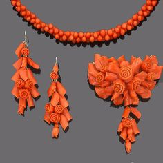 A mid-19th century carved coral suite and a child's coral necklace (4) (partially illustrated)