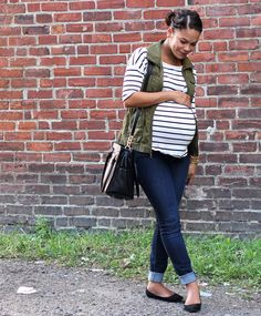 Maternity outfit: striped tee, utility vest, skinny jeans.
