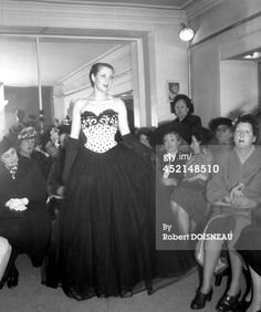 January 01, 1947  Caption: PARIS, FRANCE - 1947: Model walking the runway during a Dior winter fashion show, 1947 in Paris, France. (Photo by Robert DOISNEAU/Gamma-Rapho via Getty Images)