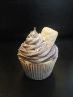 Gourmet Cupcakes. . Purple coconut and white chocolate