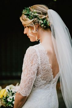 lace wedding dress - photo by Lev Kuperman http://ruffledblog.com/stylish-brooklyn-wedding-at-mymoon #weddingdress #bridal #veils