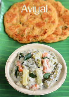 Aviyal / Avial recipe from Raks kitchen - Mixed vegetables, cooked in coconut based gravy and mixed with yoghurt/ curd and flavored with coconut oil and curry leaves!