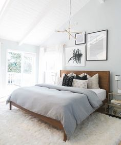 Gray and blue bedroom with tall ceilings