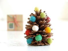 Pinecone Christmas tree. Stick various foam beads into the pinecone to make it look like an adorable miniature Christmas tree. You can even make a dozen of these to pace around the house.