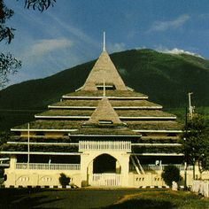 Masjid Tua in Ternate - North Maluku. Dating from the 1700s, the gracefully tiered roof is seen with the backdrop of Mount Gamalama, an active volcano.