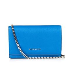"""Givenchy Electric Blue Pandora Wallet on Chain A beautifully crafted office-to-evening staple featuring a multicompartment interior concealed by a sleek leather silhouette, all finished with an elegant chain strap for dual carrying options. Chain shoulder strap. Snap flap closure. Lambskin lining. Includes dust bag. 8"""" W X 4"""" H X 1"""" D. Goatskin. Color: electric blue Brand new with tag. Bought at Saks Fifth Avenue in NYC. PLS SUBMIT OFFER THROUGH THE OFFER BUTTON, I WILL NOT NEGOTIATE IN THE…"""