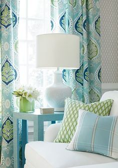 Mixed patterns in shades of Navy, aqua, green and white. Love the look? Call Loom Decor and they'll send you all of the swatches you need for free to coordinate with existing prints in your room.