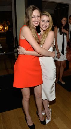 """Taissa Farmiga and Emma Roberts attend the Premiere Of FX's """"American Horror Story: Coven"""" after party at Fig & Olive Melrose Place on October 5, 2013 in West Hollywood, California."""