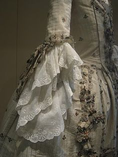 Resplendent in its glass cabinet at the Leeds City Museum, this 18th century gown is in wonderful condition. Just look at that white lace.  Kenneth Sanderson's 18th Century Dress. Read more at The Vintage Copywriting Blog.