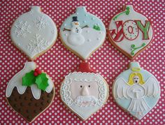 Christmas cookies for the Royal Show by Sugary Flower, via Flickr - ornaments with snow flakes, snow man, JOY, holly on pudding, Santa, and angel decorated cookies