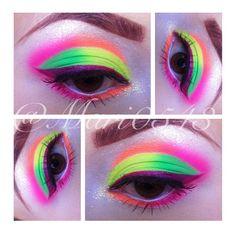 Neon pink, orange, green, and yellow eyeshadow with purple eyeliner by @mari0543. #makeup #cosmetics #beauty