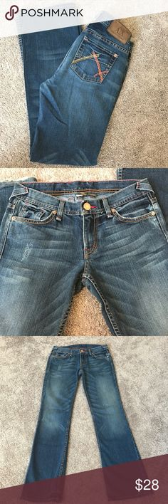 Armani Exchange distressed jeans Armani Exchange distressed jeans. Boot cut style. The colors of the stitching are beautiful! Look closely at the stitching and you will see coral and peach on the back pockets, as well as some peach, red and a tiny bit of blue in the front. Armani Exchange Jeans Boot Cut