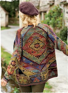 Concentric diamonds from a Turkish kilim are recast in hand-tweeded, space-dyed hues, ranging from terra cotta, sand and lavender to aqua, olive and gold. This gallery-worthy Kaffe Fassett art knit is generously sized, with drop shoulders, a buttonless placket and a striped border. Pima (60%) and alpaca (40%).