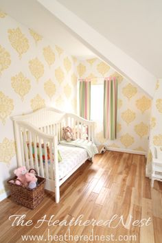 This wallpaper makes such a statement in this big girl room!