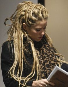 Shakira's dreads. These are temporarily like that, you tease your strands and put gel in them so they are like this, and since they are temporary, you can comb it out. Been wanting these since I saw Shakira wearing them!
