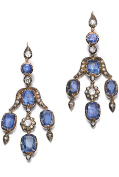 PAIR OF SAPPHIRE AND DIAMOND EARRINGS, LATE 19TH TO EARLY 20TH CENTURY Each of girandole design, suspending a fringe of cushion-shaped sapphires, interspersed with circular-cut and rose diamonds.